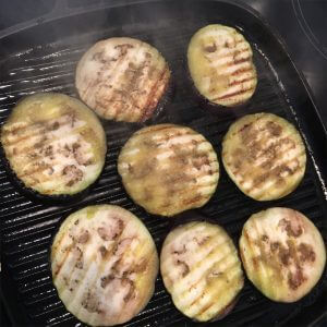 Grilled aubergine slices.